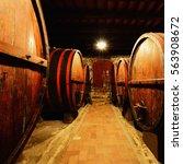 old barrels in wine cellar | Shutterstock . vector #563908672