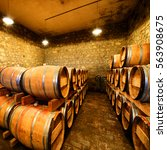 old barrels in wine cellar | Shutterstock . vector #563908675
