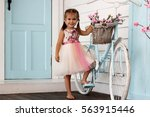 pretty small girl in beautiful... | Shutterstock . vector #563915446