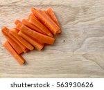 a pile of fresh carrots cut...   Shutterstock . vector #563930626