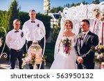 bride and groom on wedding... | Shutterstock . vector #563950132