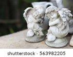 A Statue Couple Angle Cupids...