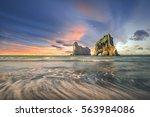 Stock photo wharariki beach new zealand at sunset scenery 563984086