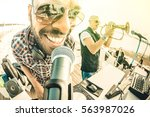 dj playing cool summer hits at... | Shutterstock . vector #563987026