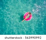 aerial view of young brunette... | Shutterstock . vector #563990992