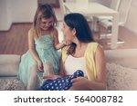 mom and daughter having... | Shutterstock . vector #564008782