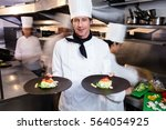 happy head chef presenting his... | Shutterstock . vector #564054925