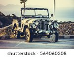 Khaki Military Jeep In The...