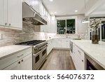 gourmet kitchen features white... | Shutterstock . vector #564076372