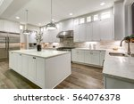 Stock photo gourmet kitchen features white shaker cabinets with marble countertops stone subway tile 564076378