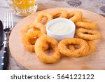 fried squid rings served on a... | Shutterstock . vector #564122122