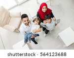 happy muslim family at modern... | Shutterstock . vector #564123688