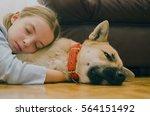 Little Girl Embracing Her Dog...