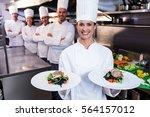 team of chefs in the kitchen... | Shutterstock . vector #564157012