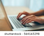 Woman Hands Typing On Laptop...