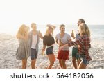 happy friends dancing together... | Shutterstock . vector #564182056