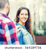 Small photo of Handsome guy trying to get acquainted with pretty girl outdoors