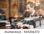 dedicated businessman at work | Shutterstock . vector #564206272