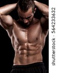 bodybuilder on black background | Shutterstock . vector #564233632