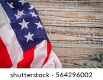american flag on wood background | Shutterstock . vector #564296002