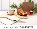 notebook and pen | Shutterstock . vector #564338692
