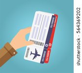 hand holding boarding pass... | Shutterstock .eps vector #564369202