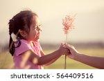 happy asian little girl giving...   Shutterstock . vector #564409516