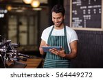 smiling barista using tablet in ... | Shutterstock . vector #564449272