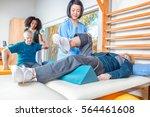 rehab clinic gym. multi racial... | Shutterstock . vector #564461608