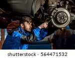 young handsome auto mechanic at ... | Shutterstock . vector #564471532