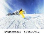 girl snowboarder moving fast... | Shutterstock . vector #564502912