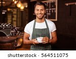 smiling barista holding coffee... | Shutterstock . vector #564511075