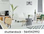 living room area of a cozy loft ... | Shutterstock . vector #564542992