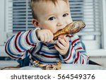 the child greedily eating... | Shutterstock . vector #564549376