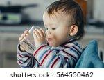 portrait of a boy drinking a... | Shutterstock . vector #564550462
