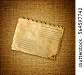 vintage envelop on brown canvas | Shutterstock . vector #564597742