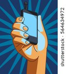 hand holding smart phone.  | Shutterstock .eps vector #564634972