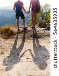 shade of couple on hill | Shutterstock . vector #564635935
