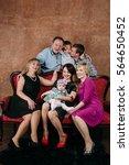 three generation family sitting ... | Shutterstock . vector #564650452