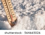 wooden thermometer in the snow... | Shutterstock . vector #564665026