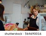 unrecognizable customer using... | Shutterstock . vector #564690016