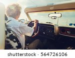 old man in a convertible... | Shutterstock . vector #564726106