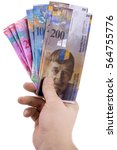 male hand is holding swiss... | Shutterstock . vector #564755776