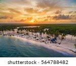 sunset over juanillo beach | Shutterstock . vector #564788482