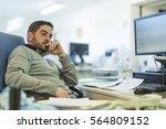 office worker in real office... | Shutterstock . vector #564809152