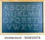 alphabets written on greenboard | Shutterstock . vector #564810376