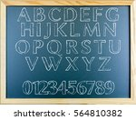 alphabets written on greenboard | Shutterstock . vector #564810382