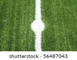 point lines on soccer field green grass - stock photo