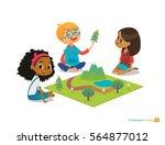 children sitting on floor... | Shutterstock . vector #564877012
