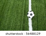 football on soccer field with line - stock photo